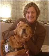 Meg Olmert with one of WCC's dogs, Valerie.
